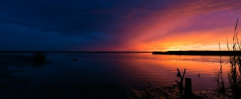 A landscape photograph of a fierce sunset to the south of Great Bay Boulevard in Little Egg Harbor, New Jersey