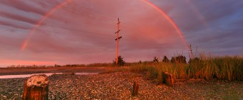 Photograph of a double rainbow that formed opposite the setting sun on Great Bay Boulevard in Little Egg Harbor Township