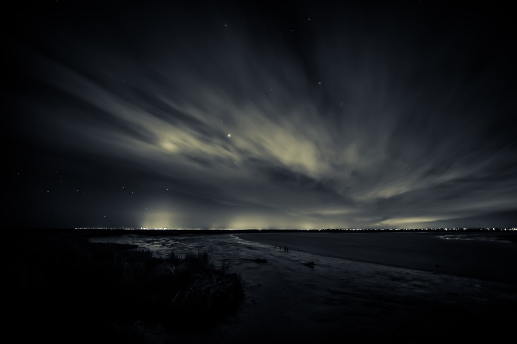 A moody long exposure night photograph overlooking the marshland toward Atlantic City.