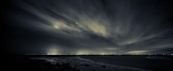 A moody long exposure night photograph overlooking the marshland toward Atlantic City.