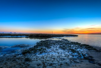 An HDR photograph taken from the southern side of Edwin B. Forsythe National Wildlife Refuge overlooking the Atlantic City skyline at sunset.