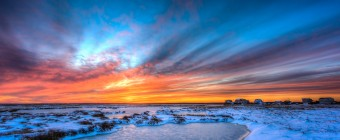 An HDR photograph of a rare event: a full spectrum sunset over a snow covered, frozen marsh south of Cedar Run Dock Road.