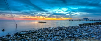 An HDR photograph taken at the end of Cedar Run Dock Road overlooking the bay to the south taken just after sunset.