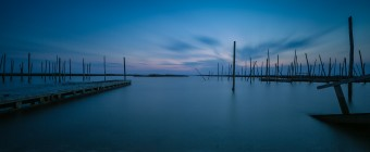 A long exposure photograph overlooking Great Bay during blue hour taken by Manahawkin, NJ photographer Greg Molyneux from an abandoned boat ramp on Great Bay Boulevard.