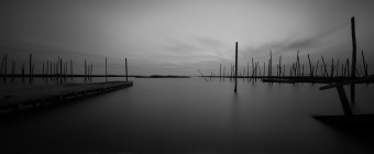 Manahawkin, NJ photographer Greg Molyneux takes a long exposure black and white photograph of the bay and abandoned docks on Great Bay Boulevard.
