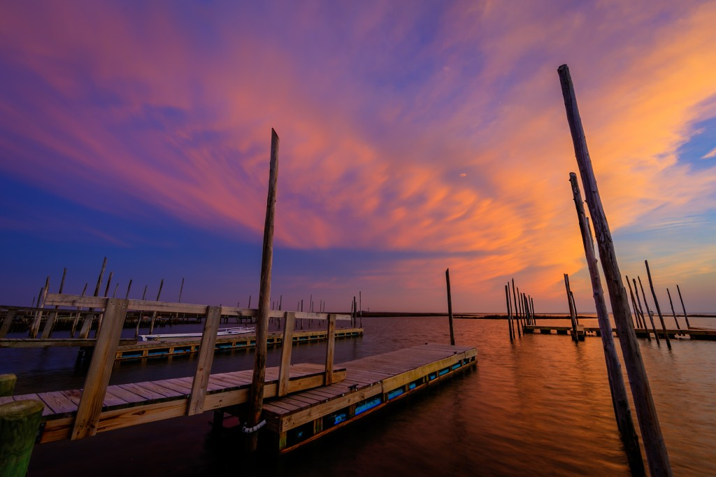 An HDR photograph taken at sunset from Rand's on Great Bay Boulevard featuring an imposing cloud deck backing in off the ocean awash in pinks and purples from the just departed sun.