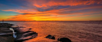 Overlooking a calm Barnegat Bay, this HDR photograph features an unbelievably intense sunset with striking orange, yellow and pink. All backed in a rich turquoise. Taken mere hours before the start of Fall.