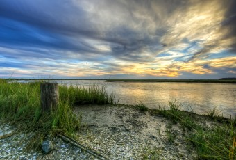 An HDR photograph taken of the salt marsh on the south side of Great Bay Boulevard during golden hour.