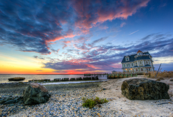 Winter sunset colors and clouds rolling in from the west, dramatically backdropping Antoinetta's restaurant over Manahawkin Bay in this HDR photograph.