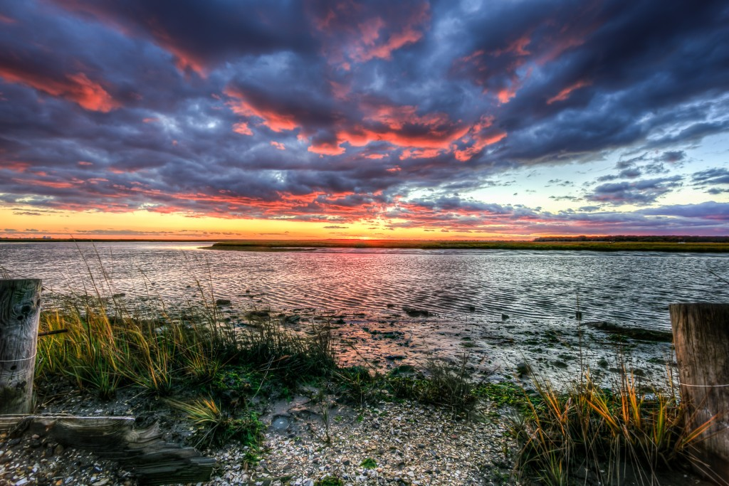 Looking for a dramatic sunset photograph? Here it is, an HDR marsh sunset in all its saturated color glory. Strong shadows and deep contrast are the hallmark of this seascape picture.