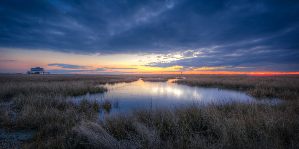 A soft focus HDR photograph taken along the Cedar Run Dock Road marsh at sunset.