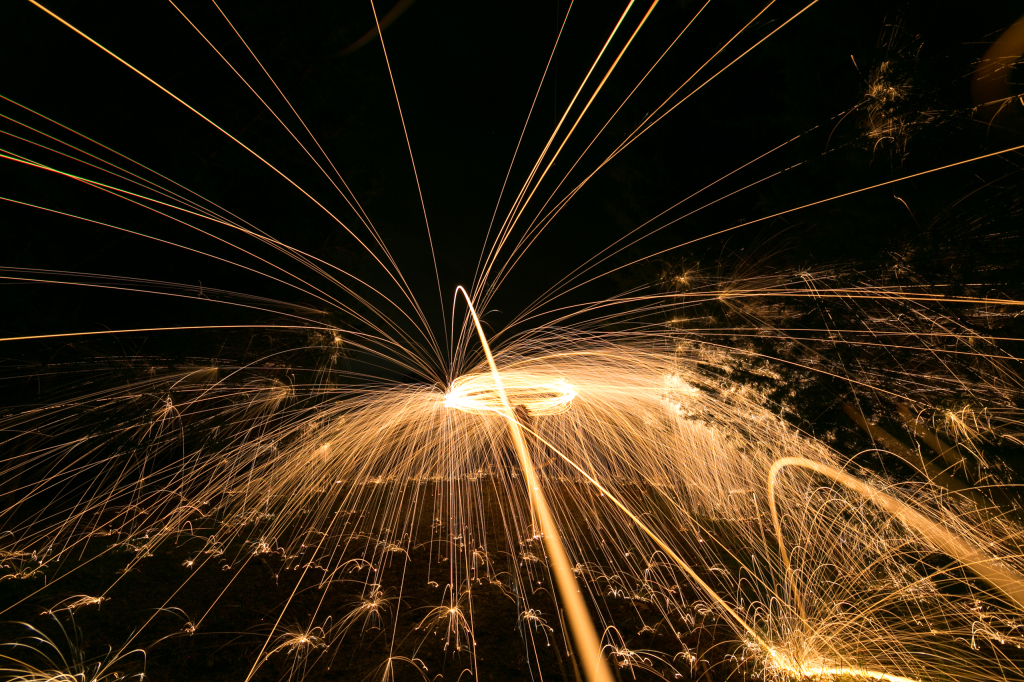 Spinning steel wool overhead to light paint a position reminiscent of a resplendent She-Ra lifting her sword.