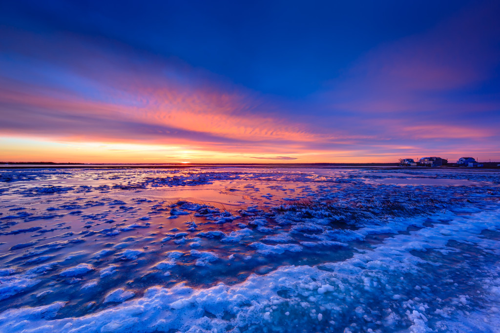 After Winter Storm Juno skirted the Jersey shore sparing New Jersey from historic snow, the clouds break revealing a sublime winter sunset on the frozen marsh along Cedar Run Dock Road in this HDR photograph.