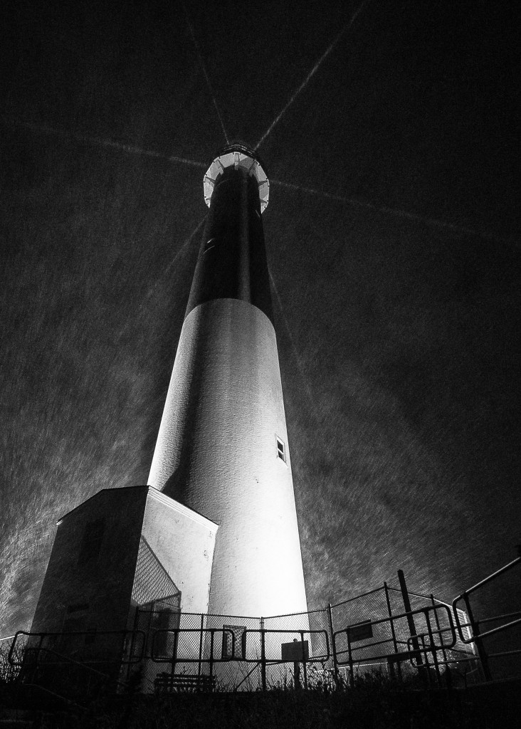 Heavy mesoband snow and wind batter Barnegat Lighthouse as winter storm Juno skirts the New Jersey coast in this low key black and white photograph of a resolute and unmoving Old Barney at night.