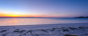 A serene blue hour befalls a calm Barnegat Bay in this wide angle HDR photograph taken from the secluded shores of High Bar Harbor, Long Beach Island, New Jersey.