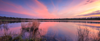 Pastel skies over a calm lake reflection in this HDR photograph taken at Stafford Forge Wildlife Management Area