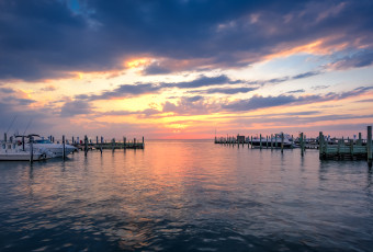 HDR sunset photograph of clouds, water, boats, docks and light made from Beach Haven, LBI. overlooking Little Egg Harbor