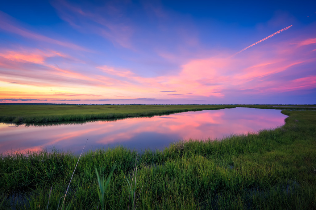 HDR photograph of pastel sky colors at blue hour overlooking a marsh