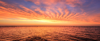 HDR photograph of a fiery sunset over Barnegat Bay as seen from Surf City, NJ