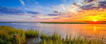 HDR photograph of a summer sunset over marsh and estuary