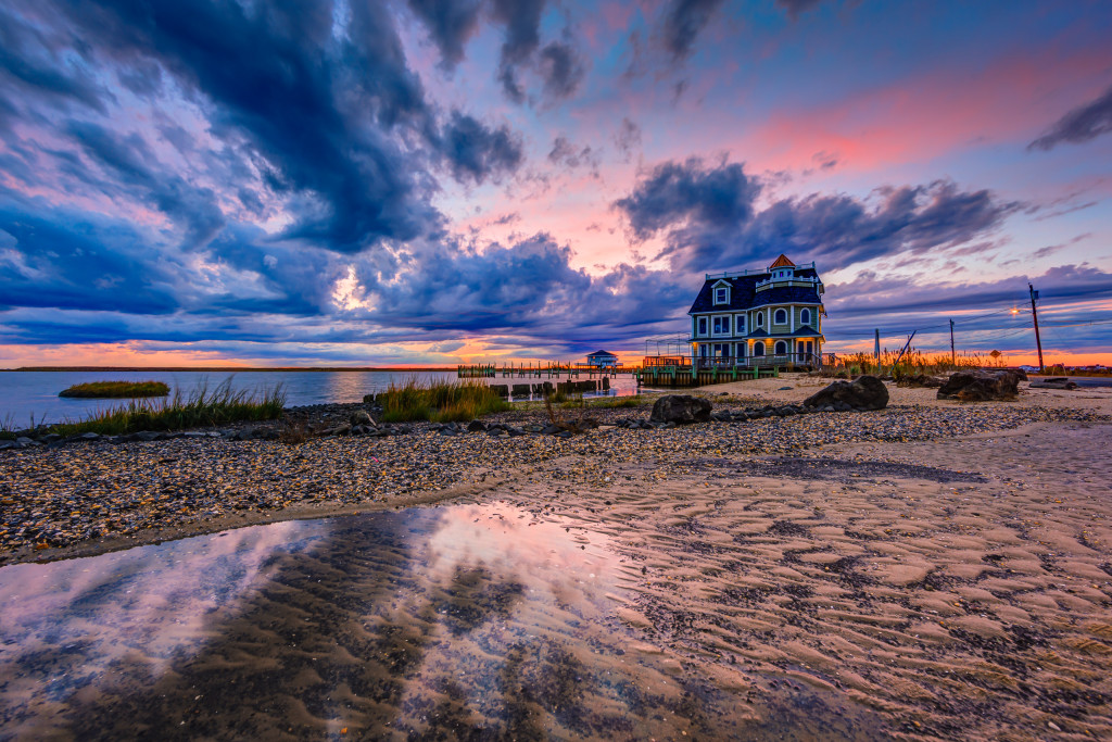 Wide angle HDR landscape photograph of ominous clouds backlit by a pastel sunset at Antoinetta's Restaurant
