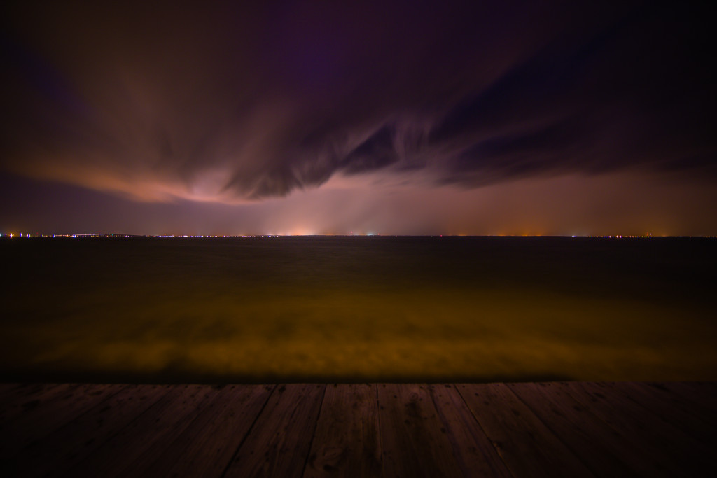 Wide angle long exposure photograph of a demonic shelf cloud over Barnegat Bay