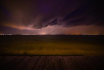 Wide angle long exposure photograph of a demonic shelf cloud over Barnegat Bay
