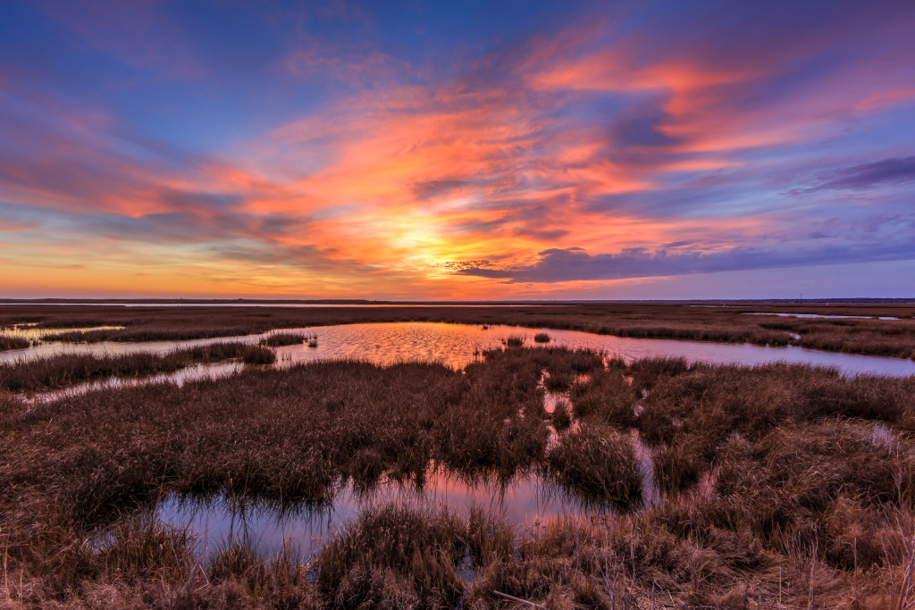HDR landscape photograph of dramatic clouds and pastel colors at sunset