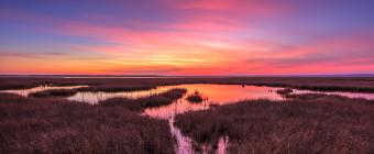 Landscape HDR photograph of pastel color cirrus clouds at sunset