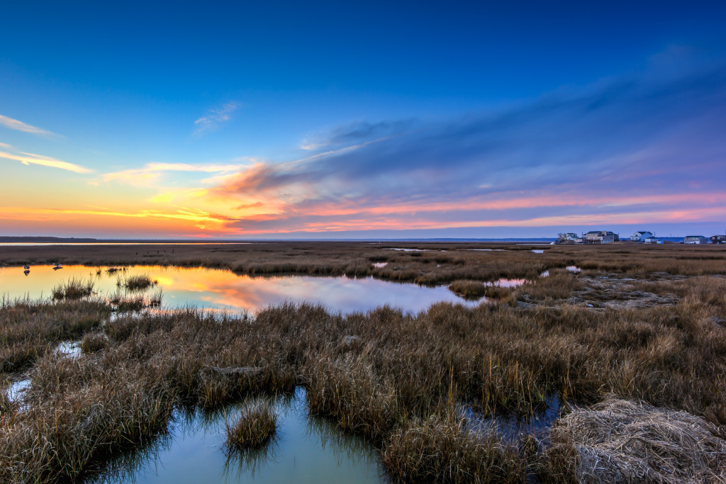 HDR landscape photograph of sunset fading to blue hour over the salt marsh