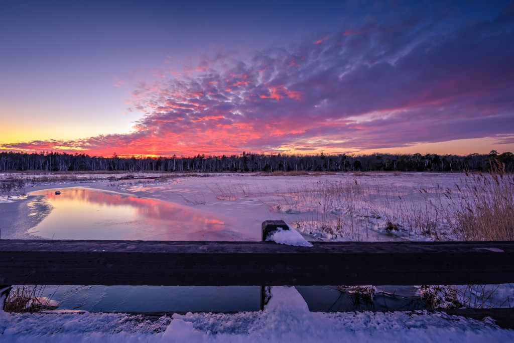 Sunset photograph taken atop a bridge overlooking a frozen marsh a day after Winter Storm Jonas