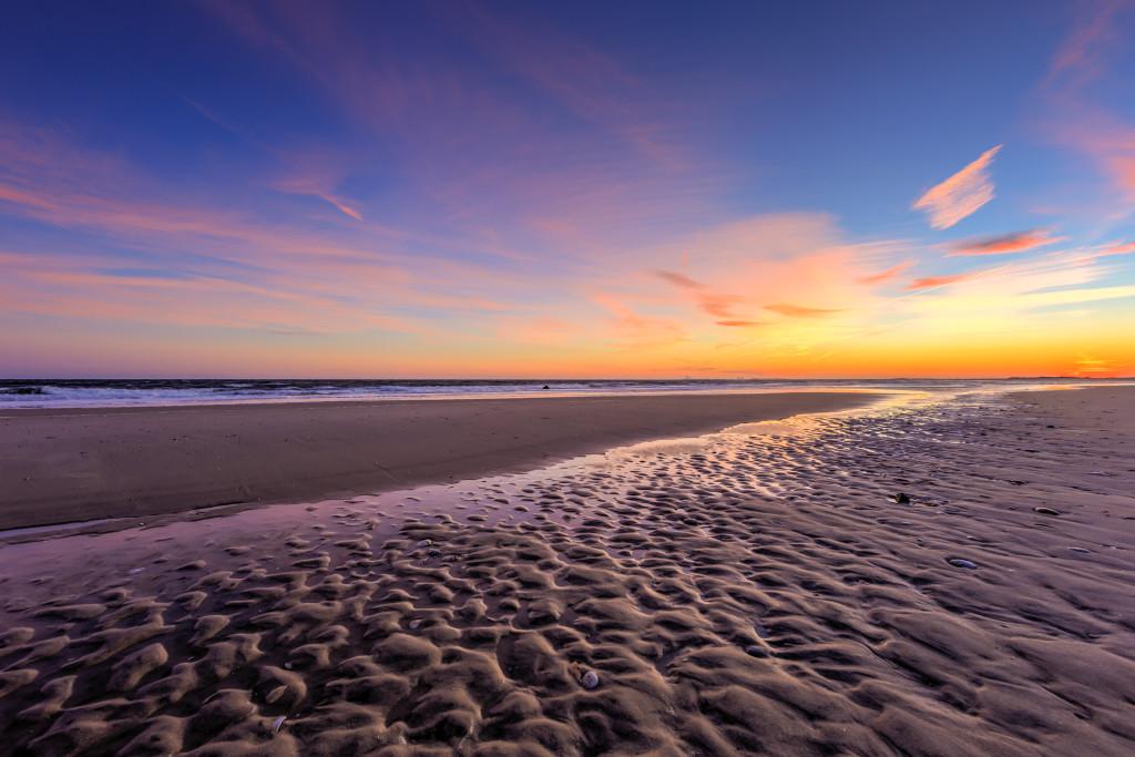 Landscape photograph of Holgate, NJ, beaches under a pastel winter sunset