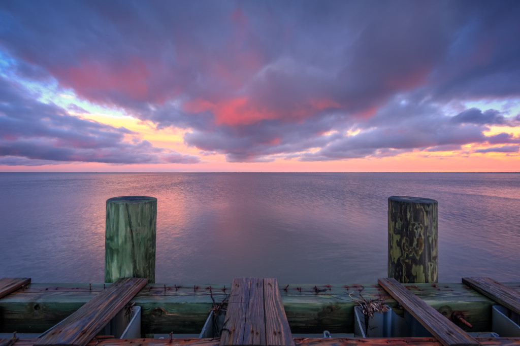 Sunset photograph overlooking Barnegat Bay and a decrepit bulkhead