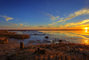 Golden hour photo of dead low tide at the Great Bay Boulevard salt marsh