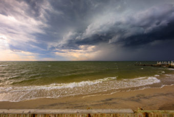 Wide angle photograph of an ominous shelf cloud storming over Barnegat Bay en route to Long Beach Island