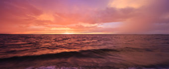 Sunset photograph of dramatic clouds painted in fiery pastels left behind after storms rolled through Long Beach Island.