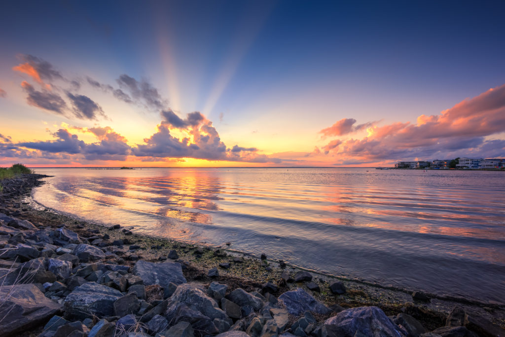 HDR sunset photo with beaming crepuscular rays.