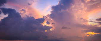 Storm photograph of a sunset thunderstorm over Manahawkin Bay with lightning bolt.