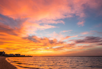 Fiery sunset photograph of explosive cloud color over Barnegat Bay.