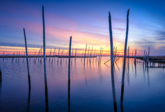 Blue hour HDR photo of a derelict Rand's Marina and cedar poles.