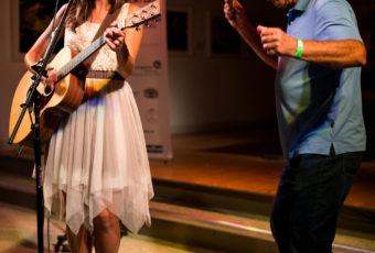Guitarist Sahara Moon and harmonica player Gordon Woolley play a duet.