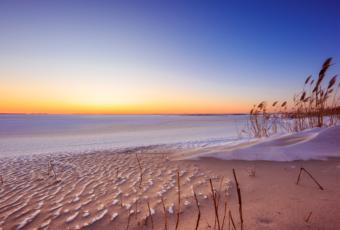 Sunset photo over frozen Barnegat Bay in Harvey Cedars, NJ.