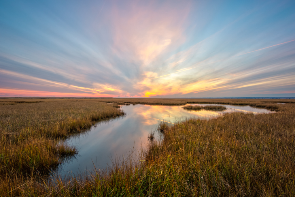 14mm wide angle sunset photo over salt marsh.