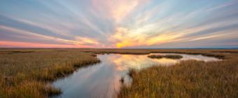 14mm wide angle sunset photo over salt marsh.