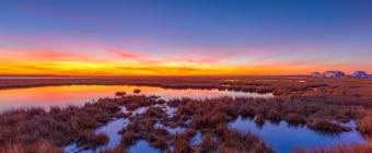 14mm wide angle sunset photo made on Christmas Eve 2019, glowing over Cedar Run Dock Road salt marsh.