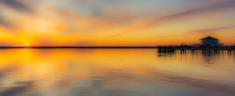 35mm photo capturing a golden sunset lighting the calm water of Little Egg Harbor to mark 2019 winter solstice.