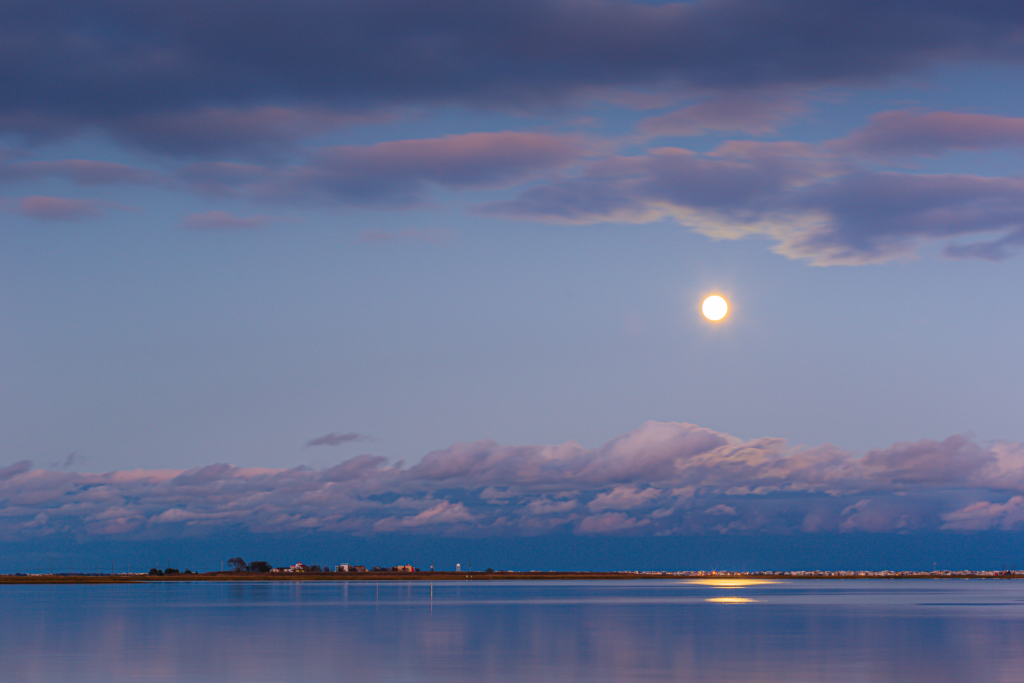 moon rise over Parkertown Cove at Parkertown Docks at blue hour. This was October 2020's second full moon making it a blue moon.