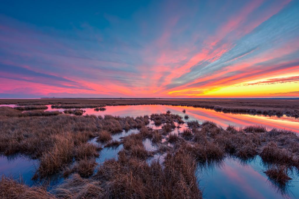 14mm wide angle sunset photo made in winter over the dormant Cedar Run Dock Road salt marsh.