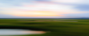 35mm out of focus photo of Cedar Run Dock Road salt marsh made with motion blur by panning the camera left to right.