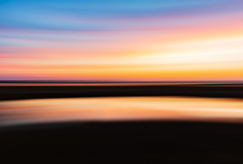 35mm motion blur sunset photo of New Jersey salt marsh in autumn. Panning creates a left to right streak blurred abstraction of Samus Aran's shinespark racing across the sky.